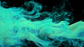 cyan turquoise color paint ink drops in water inky cloud swirling smoke alpha