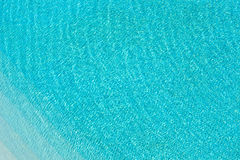 Cyan water abstract background. From water surface in swimming pool Royalty Free Stock Images