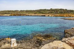 The cyan water of the Blue Lagoon, Comino, Malta. The cyan water and typical landscape of the Blue Lagoon, Comino Island harbor, Malta royalty free stock images