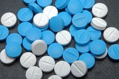 Cyan and white pill. Macro view of cyan and white pills from above Royalty Free Stock Images
