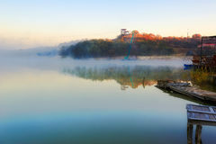 The cyan Xiaoqing lake and morning fog Stock Photography