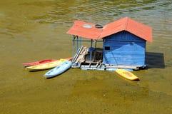Cyanobacteria in Lake Atitlan Guatemala. Cyanobacteria Lyngbya algae bloom in Lake Atitlan Guatemala with unused kayaks parked at a floating boathouse royalty free stock photos