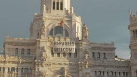 Cybele Palace with banner Refugees Welcome