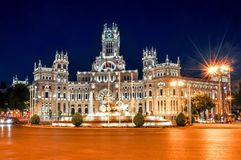 Cybele palace and fountain on Cibeles square at night, Madrid, Spain stock images