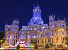 Cybele Palace and fountain illuminated at night in Madrid, Spain stock images
