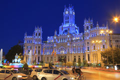 Cybele Palace and fountain illuminated at night in Madrid, Spain stock photo