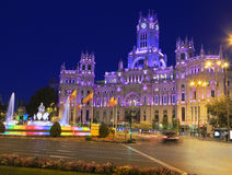 The Cybele Palace and fountain illuminated at night in Madrid, Spain royalty free stock image
