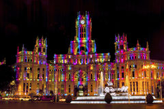 Cybele Palace in Madrid. Cybele Palace at the Plaza de Cibeles with light trails of the traffic at night, Madrid, Spain. Colorful illumination, Cybele fountain Royalty Free Stock Image