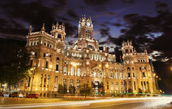 Cybele Palace at the Plaza de Cibeles with light trails of the traffic night, Madrid, Spain stock images