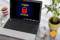 Cyber attack concept on a laptop. Laptop on a desk with cyber attack concept on the screen stock photos