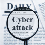 Cyber attack under magnifying glass. Cyber attack headline under magnifying glass stock images