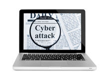 Cyber attack under magnifying glass on a laptop Stock Photography
