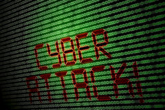 Cyber attack. Written on a computer screen with 1s and 0s Royalty Free Stock Photo