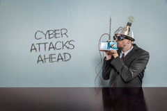 Cyber attacks ahead text with vintage businessman. Kissing machine royalty free stock image
