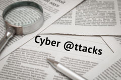 Cyber attacks analysis. On newspaper royalty free stock photo