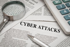Cyber attacks analysis. On newspaper stock images