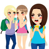 Cyber Bullying Student Girls. Two student girls making cyber bullying with smartphone to student girl reacting angry Stock Photography