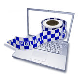 Computer Crime Security Hack. A laptop computer with a police crime scene tape coming out of the screen Royalty Free Stock Images