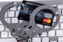 Cyber Crime. Computer keyboard and handcuffs Stock Images