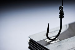 Cyber crime. / credit card phishing attack / A pile of credit card and a hook Royalty Free Stock Image