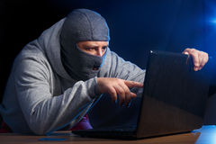 Cyber crime. Cyber criminal hacking into a computer. Industrial espionage Royalty Free Stock Photos