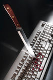 Cyber Crime with Knife Stabbing Computer Keyboard Stock Images