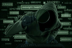Cyber criminal looking for information Royalty Free Stock Photography