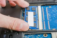 Broken laptop, motherboard failure, hard drive, hardware problems, backup of information stock photo