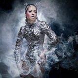 Cyber girl. Portrait of fantasy cyber girl in smoke Royalty Free Stock Photos