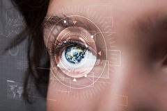 Cyber girl with technolgy eye looking Stock Photography