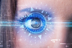 Cyber girl with technolgy eye looking into blue iris. Modern cyber girl with technolgy eye looking into blue iris Stock Photo