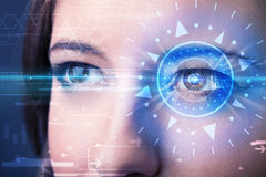 Cyber girl with technolgy eye looking into blue iris. Modern cyber girl with technolgy eye looking into blue iris Royalty Free Stock Photos