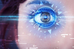 Cyber girl with technolgy eye looking into blue iris Royalty Free Stock Photography