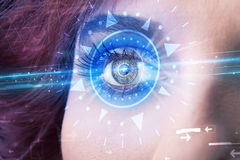 Cyber girl with technolgy eye looking into blue iris Royalty Free Stock Photo
