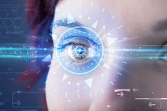 Cyber girl with technolgy eye looking into blue iris Stock Images