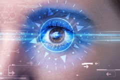 Cyber girl with technolgy eye looking into blue iris. Modern cyber girl with technolgy eye looking into blue iris Royalty Free Stock Photo