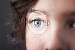 Cyber girl with technolgy eye looking Stock Photo