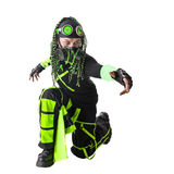 Cyber Goth guy sitting on one knee. Cyber Goth guy with the green dreadlocks pulling his hand into the distance. isolated on white Stock Photo