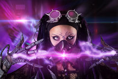 Cyber-Gothic girl. Cyber Gothic girl with rays of light in a dark background Stock Photo