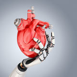 Cyber Heart. Mechanical heart in robots hand. Clipping path included Royalty Free Stock Images
