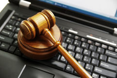 Cyber law. Judges gavel on a laptop computer (cyber law Stock Photography