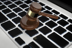 Cyber law concept. With 3d rendering gavel judge on computer keyboard Royalty Free Stock Photos