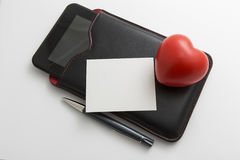 Cyber love concept with tablet, heart and pen Stock Photography