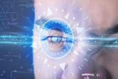 Cyber man with technolgy eye looking into blue iris Stock Photos