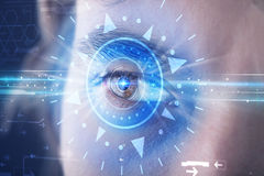Cyber man with technolgy eye looking into blue iris. Modern cyber man with technolgy eye looking into blue iris royalty free illustration