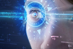 Cyber man with technolgy eye looking into blue iris Royalty Free Stock Photos