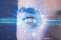 Cyber man with technolgy eye looking into blue iris. Modern cyber man with technolgy eye looking into blue iris stock illustration