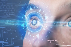 Cyber man with technolgy eye looking into blue iris Stock Photography