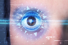 Cyber man with technolgy eye looking into blue iris Stock Image