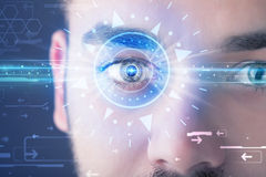 Cyber man with technolgy eye looking into blue iris Royalty Free Stock Image
